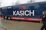 Hempstead, New York, USA. April 4, 2016. A Nassau County Police Officer is stationed at the John Kasich Campaign Bus about to leave campus, after the Republican presidential candidate and governor of Ohio, hosted a Town Hall at Hofstra University David Mack Student Center in Long Island. Bus has slogan 'RESULTS. NOW. FOR US.' written on the side. The New York primary is April 19, and Kasich is the first of the three GOP presidential candidates to campaign in Nassau and Suffolk Counties, and is in third place in number of delegates won.