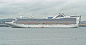 South Queensferry, Scotland, GBR - August 18, 2005 -- .The Golden Princess, one of the largest cruise ships operated by Princess Cruises is anchored in the harbor of South Queensferry, Scotland, GBR on August 17, 2005.  The ship, which is 951 feet (289.86 meters)long and weighs 109,000 tons (98,883,143.2 kg), was completed on October 1, 2001.  It has facilities for 2600 passengers and 1100 crew.  It has a maximum speed of 22 knots..Credit: Ron Sachs / CNP
