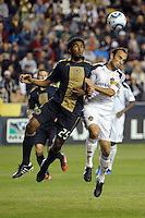 Sheanon Williams (25) of the Philadelphia Union and Landon Donovan (10) of the Los Angeles Galaxy go up for a header. The Los Angeles Galaxy defeated the Philadelphia Union  1-0 during a Major League Soccer (MLS) match at PPL Park in Chester, PA, on October 07, 2010.