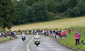 Police motorcyclists preceed the cyclists.  Olympics 2012.  Women's cycle road race passes along the Shere bypass, the A25, on it's way to Box Hill and then back to the finish in London.