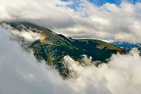 The Val di Norcia through low clouds, Umbria, Italy