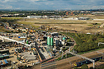 Looking down and eastward onto the proposed east London the site of the 2012 Olympic Games, village and arena. Carpenters road and industrial site, the new Stratford International railway station. Stratford, England 2006.