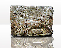 Picture & image of a Neo-Hittite orthostat with a chariot Releif sculpture from Karkamis,, Turkey. Ancora Archaeological Museum. The Cahiot is pulled by horses with plumed headresses. One man os about to shoot an arrow from his bow, the other man is driving the cahriot. Below the horse is a animal cowering. 2
