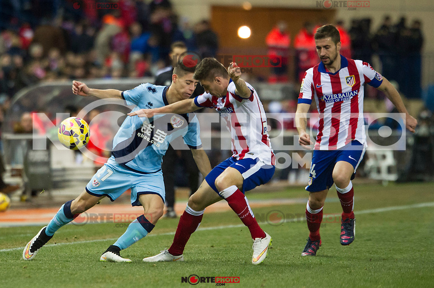 Atletico de Madrid&acute;s Guilherme Siqueira and Gabi and Rayo Vallecano&acute;s Alex Moreno during 2014-15 La Liga match between Atletico de Madrid and Rayo Vallecano at Vicente Calderon stadium in Madrid, Spain. January 24, 2015. (ALTERPHOTOS/Luis Fernandez) /NortePhoto<br />