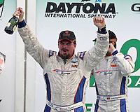 JC France  celebrates his podium finish in the Rolex 24 at Daytona , Daytona International Speedway, Daytona Beach, FL, January 2009.  )Photo by Brian Cleary)