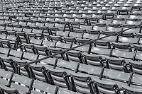 "Empty grandstand seats in Fenway Park wait for the next home game to be filled with fans of the ""Red Sox Nation"".  Fenway is the oldest ballpark in Major League Baseball, dating from 1912."