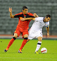 USA's Carlos Bocanegra (r) and Belgium's Igor De Camargo fight for the ball during the friendly match Belgium vs USA at King Baudoin stadium in Brussels, Belgium on September 06th, 2011.