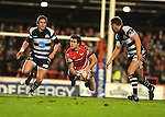 Gavin Evans makes a diving pass. Scarlets V Bristol, EDF Energy Cup  © Ian Cook IJC Photography iancook@ijcphotography.co.uk www.ijcphotography.co.ukUnholy Alliance Tour 2008,