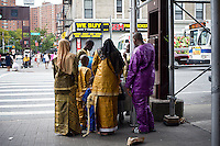 A Muslim family seen on a street corner in the neighborhood of Harlem in New York on Sunday, August 19, 2012.  ( © Frances M. Roberts)