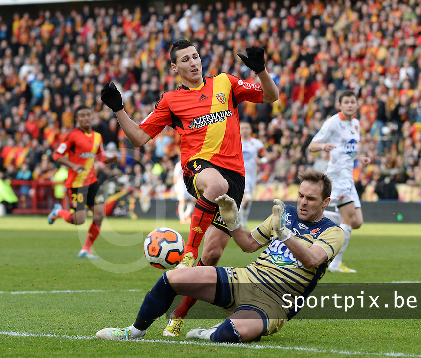 20140201 - LENS , FRANCE : RC Lens's Yoann Touzghar pictured in a duel with Laval's goalkeeper Lionel Cappone (r) during the soccer match between Racing Club de LENS and Stade Lavallois , on the twenty second matchday in the French Ligue 2 at the Stade Bollaert Delelis stadium , Lens . Saturday 1st February 2014. PHOTO DAVID CATRY
