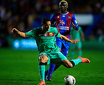 Levante's Kone (R) vies for the ball with FC Barcelona's Adriano (L) during the Spanish league football match Levante UD vs FC Barcelona on April 14, 2012 at the Ciudad de Valencia Stadium in Valencia. (Photo by Xaume Olleros/Action Plus)
