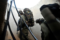 Israeli infantry soldiers are deployed near the Israel-Gaza border. Israeli forces began an air offensive against Hamas in Gaza on 27/12/2008, which quickly escalated into an offensive by land, sea and air, in retaliation against Palestinian rockets fired into Israel. After eight days of bombardment, leaving over 400 Palestinians and four Israelis dead, Israeli tanks entered Gaza on 04/01/2009...