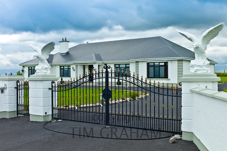 New modern bungalow, typical of extensive new development in Ireland, at Curragh West, County Galway, Ireland