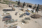 Captured weapons, ammunition and medical supplies are stacked in neat rows after Canadian and Afghan soldiers discovered a cache of Taliban materiel in the village of Nakhonay, southwest of Kandahar, Afghanistan. Although no fighting took place during the five day operation, the find confirmed intelligence reports that the village serves as a rest and resupply area for the Taliban. Oct. 8, 2008. DREW BROWN/STARS AND STRIPES