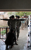 SULAIMANIYAH, IRAQ; Policemen vote in Sulaimaniyah..Three days before the polls open, military and convicts vote in the Iraqi Parliamentary Elections....Photo by Hawre Majid/ Metrography