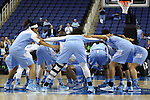 27 March 2015: UNC players huddle before the game. The University of North Carolina Tar Heels played the University of South Carolina Gamecocks at the Greensboro Coliseum in Greensboro, North Carolina in a 2014-15 NCAA Division I Women's Basketball Tournament regional semifinal game. South Carolina won the game 67-65.