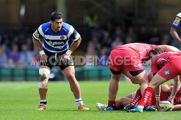 Alafoti Fa'osiliva stands in defence. Pre-season friendly match, between Bath Rugby and the Scarlets on August 16, 2014 at the Recreation Ground in Bath, England. Photo by: Patrick Khachfe / Onside Images
