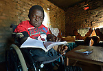 Peter Makura studies at his home in the village of Berejena, near Masvingo, Zimbabwe. Makura uses a wheelchair provided by the Jairos Jiri Association with support from CBM-US.
