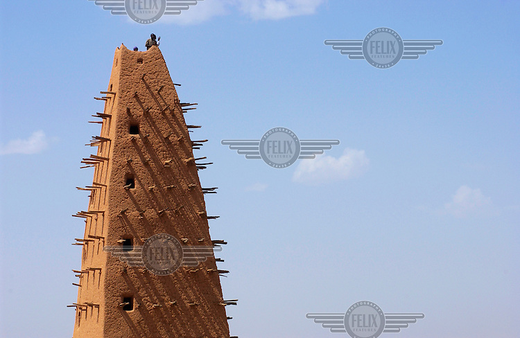 Children play on top of the mud minaret at the 16th century Grand Mosque in Agadez.