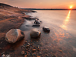 Beautiful sunrise nature scenery of red rocks on a shore of Georgian Bay at Killbear Provincial Park, Ontario, Canada.