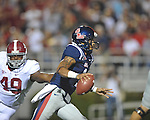 Ole Miss quarterback Randall Mackey (1) scrambles from Alabama defensive lineman Ed Stinson (49) at Vaught-Hemingway Stadium in Oxford, Miss. on Saturday, October 14, 2011. Alabama won 52-7.