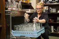 Rachael Weaver makes sure glasses are sparkling clean at The Fountain Bridge carvery restaurant and pub at Kirkby in Ashfield, Nottinghamshire.