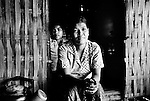 "Mekong Dam Victims - Cambodia. One of the young villagers who has moved to a new location, choosing to remain rather near the river to maintain an easy access to the town and hospital. However, they might have to move again soon because of the fast erosion of the riverbanks. At least 55.000 people living near the Sesan river in Cambodia's Ratanakiri and Stung Treng provinces continue to suffer due to lost rice production, lost fishing income, drowned livestock and damaged vegetable gardens, and so also great economical losses, because of the unpredictable floodings from the Yali Falls Dam on the other side of the border in Vietnam. To this day, flash floodings have caused the deaths of at least 39 villagers from various ethnic minority groups living along the river. Despite this, four other major hydropower projects are now in operation or under construction on the Sesan River in Vietnam. Known as ""The Mother of Waters"", more than 60 million people depend on the Mekong river and its tributaries for food, fresh water, transport and other aspects of daily life. The construction of big dams is now threatening the life of these people aswell as the vital and unique ecosystem of the river."