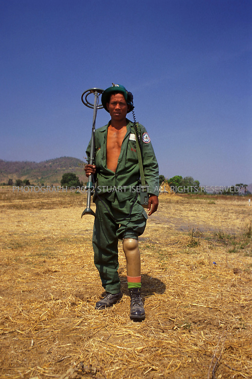 Battambang, Cambodia..A landmine victim now working for MAG, the Mines Aareness Group that is helping to clear Cambodian fields of mines....©2003 Stuart Isett All rights reserved