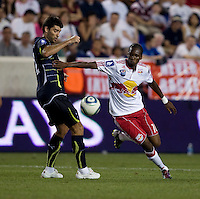 Niko Kranjcar (21) of Tottenham fights for the ball with Macoumba Kandji (10) of the New York Red Bulls during the Barclays New York Challenge at Red Bull Arena in Harrison, NY.  Tottenham defeated the New York Red Bulls, 2-1.