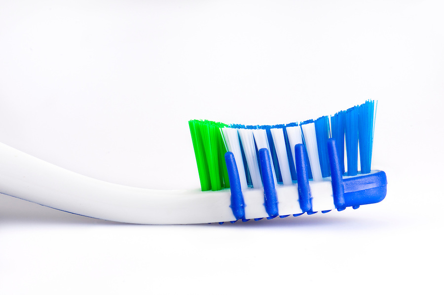 Close up of a toothbrush over white background.