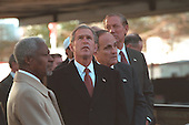 United States President George W. Bush and United Nations (UN) Secretary General Kofi Annan attend the September 11th Observance at the site of the World Trade Center terrorist attacks, Sunday, November 11, 2001. New York City Mayor Rudolph Guiliani, center, and New York Governor George Pataki are also pictured..Mandatory Credit: Eric Draper - White House via CNP.