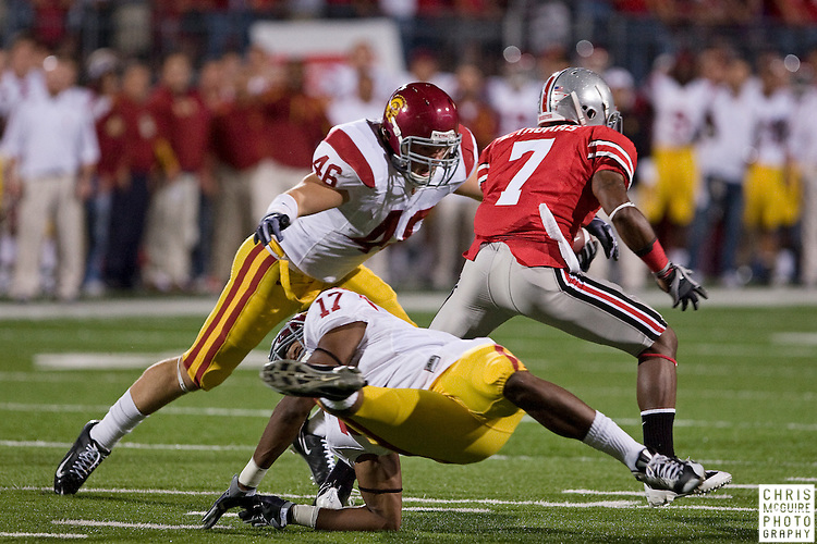 12 September 2009:  Football -- USC linebacker Ross Cumming (46) tackles Ohio State wide receiver Lamaar Thomas on a punt return during their game at Ohio Stadium in Columbus.  USC won 18-15.  Photo by Christopher McGuire.