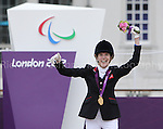 Paralympics London 2012 - ParalympicsGB - Equestrian Dressage Individual, Ind. Championship Test - Grade Ia..Sophie Christiansen with her horse Janeiro 6 wind Gold medal and celebrates after competing in the  Individual, Ind. Championship Test - Grade IV  2nd September 2012 at the Paralympic Games in London. (Photo: (Richard Washbrooke)/ParalympicsGB)