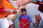 CUIDAD JUAREZ, CHIHUAHUA, MEXICO: A Tarahumara Indian girls is framed by her father and uncle as they tune their instruments before performing traditional Tarahumara music in Ciudad Juarez, Chihuahua, Mexico.  PHOTO © JACK KURTZ  family  culture  children music  poverty indigenous