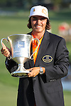 06 May 2012: Rickie Fowler holds the championship trophy during final round action at the the Wells Fargo Tournament at Quail Hollow Country Club, Charlotte, North Carolina. Rickie Fowler wins the tournament in a three-way playoff again D.A. Points and Rory McIlroy.