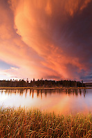 Storm clouds building over Yellowstone River and grassy meadows near sunset, Yellowstone National Park, Wyoming, USA
