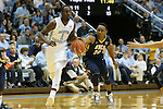 28 December 2015: UNC Greensboro's Diante Baldwin (20) strips the ball away from North Carolina's Theo Pinson (1). The University of North Carolina Tar Heels hosted the UNC Greensboro Spartans at the Dean E. Smith Center in Chapel Hill, North Carolina in a 2015-16 NCAA Division I Men's Basketball game. UNC won the game 96-63.