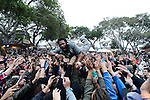 """""""Flying"""" Jay Armant of Fishbone crowdsurfs during the 2015 CaliRoots Festival in Monterey, Calif."""
