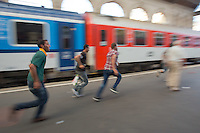 Illegal migrants rush to get on their train to travel to Germany at the main railway station Keleti in Budapest, Hungary on August 31, 2015. ATTILA VOLGYI