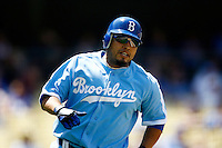 4 May 2011: Catcher #30 Dioner Navarro runs to first base after  he hit the ball. The Cubs defeated the Dodgers 5-1 during a Major League Baseball game at Dodger Stadium in Los Angeles, California.  Dodgers players are wearing Brooklyn Dodger 1940's throwback jersey uniforms and the Chicago Cubs are also wearing throwback retro jersey uniforms. **Editorial Use Only**