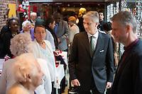 Le roi Philippe de Belgique et la reine Mathilde de Belgique lors d'une visite de No&ecirc;l au centre d'aide sociale &quot; Chamb&eacute;ry &quot;, &agrave; Bruxelles.<br /> Belgique, Bruxelles, le 22 d&eacute;cembre 2016.<br /> King Philippe of Belgium, Queen Mathilde of Belgium during a Christmas Royal visit of  ' Chambery ', welfare center in Brussels.<br /> Belgium, Brussels, 22 December 2016