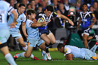 Dan Hipkiss is tackled in possession. Aviva Premiership match, between Bath Rugby and Northampton Saints on September 14, 2012 at the Recreation Ground in Bath, England. Photo by: Patrick Khachfe / Onside Images