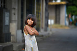 """A girl in the Manila North Cemetery. Hundreds of poor families live here, dwelling in and between the tombs and mausoleums of the city's wealthy. They are often discriminated against, and many of their children don't go to school because they're too hungry to study and they're often called """"vampires"""" by their classmates. With support from United Methodist Women, KKFI provides classroom education and meals to kids from the cemetery at a nearby United Methodist Church."""