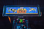 Garden City, New York, USA. December 12, 2015. Youngster plays Atari STAR WARS, a 1983 Lucasfilm Ltd and Atari Inc classic arcade video game, seen from overhead, during Opening Day of Arcade Age exhibit, in arcade set up at Cradle of Aviation Museum in Long Island. The interactive exhibit runs from Dec. 12, 2015 through April 3, 2016.