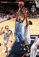 CHARLOTTESVILLE, VA- JANUARY 5: Chay Shegog #20 of the North Carolina Tar Heels shoots the ball between Kelsey Wolfe #10 and Simone Egwu #4 of the Virginia Cavaliers during the game on January 5, 2012 at the John Paul Jones arena in Charlottesville, Virginia. North Carolina defeated Virginia 78-73. (Photo by Andrew Shurtleff/Getty Images) *** Local Caption *** Simone Egwu;Kelsey Wolfe;Chay Shegog