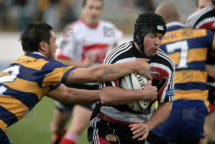 Blair Feeney tries to break past Cory Aporo during the Air NZ Cup rugby game between Bay of Plenty & Counties Manukau played at Blue Chip Stadium, Mt Maunganui on 16th of September, 2006. Bay of Plenty won 38 - 11.