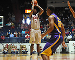 "Ole Miss' Terrance Henry (1) shoots at the C.M. ""Tad"" Smith Coliseum in Oxford, Miss. on Saturday, February 25, 2012. (AP Photo/Oxford Eagle, Bruce Newman).."