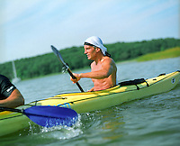 Shirtless man kayaking in East Hampton, NY