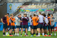 The World Cup logo with England manager Roy Hodgson addresses the England team before training