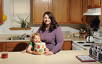 NWA Democrat-Gazette/ANDY SHUPE - Debi England's favorite place  in her Greenland home is her kitchen that she shares with her 4-year-old granddaughter, Daphine. Wednesday, March 18, 2015.